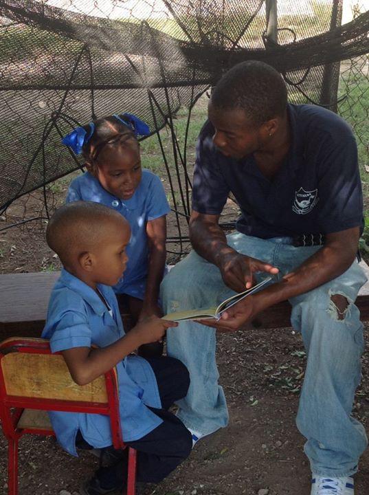 UWI Uncles read to children