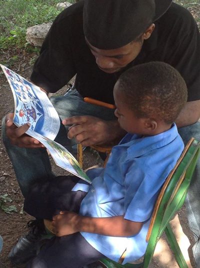 Christopher Munroe reads to children at Hermitage Basic School