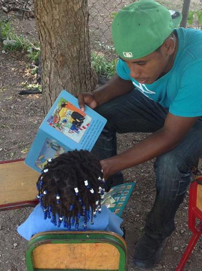 Marksman Bedward reads to children at Hermitage Basic School